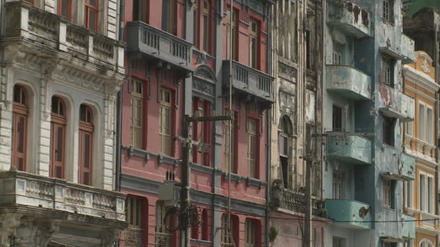 apartment buildings feature balconies in a residential area of recife, brazil. - recife stock videos and b-roll footage