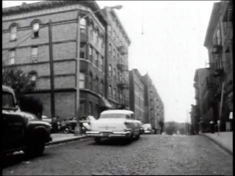 1965 ds apartment buildings in a poor, trash-riddled bronx neighborhood / new york city, new york, united states - bronx new york stock videos and b-roll footage