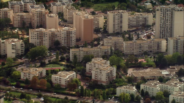 aerial apartment buildings/ paris, france - suburban stock videos & royalty-free footage