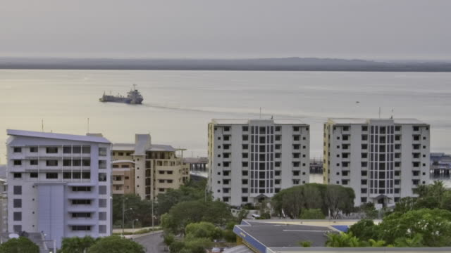 T/L WS ZO Apartment buildings with harbor in background / Darwin, Northern Territory, Australia