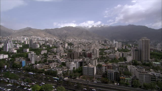 ws ha apartment buildings with mountains covered with fog in background, north tehran, iran - tehran stock videos and b-roll footage