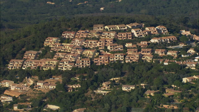AERIAL Apartment complex and houses under construction on top of hill/ La Croix Valmer, France