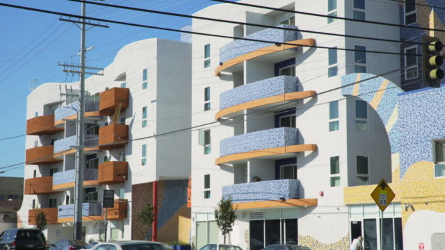 apartment complex in east los angeles - day - flat stock videos & royalty-free footage