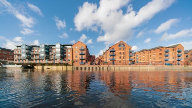 apartment on the river aire in leeds, yorkshire -4k time-lapse - riverbank stock videos & royalty-free footage