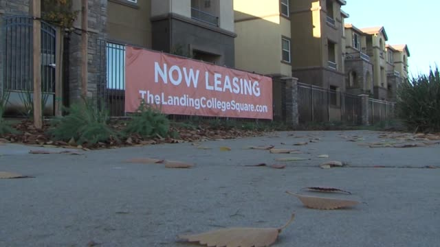 ktxl apartments and 'now leasing' signs - lease agreement stock videos & royalty-free footage