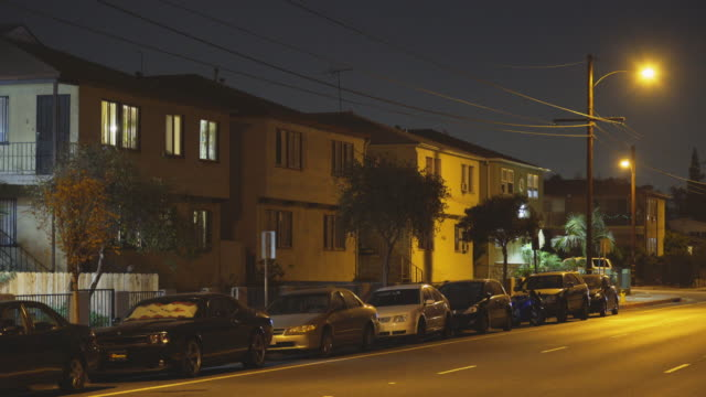 apartments in east los angeles - night - cars parked in a row stock videos & royalty-free footage