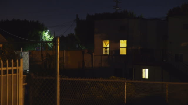 apartments in east los angeles - night - recinzione video stock e b–roll