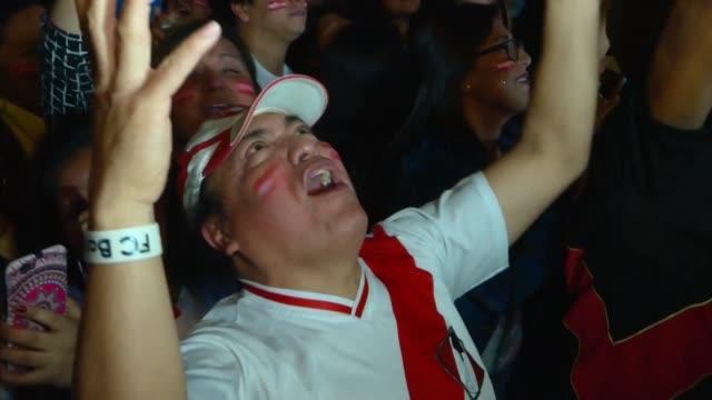apenas el árbitro toco el pitazo final los peruanos explotaron de alegría desde el estadio arena do gremio de porto alegre hasta las calles de lima... - alegre stock videos & royalty-free footage