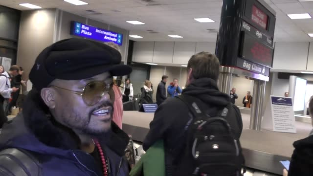 apl de ap arriving to the Sundance Film Festival at Salt Lake City Airport in Utah in Celebrity Sightings in Park City UT