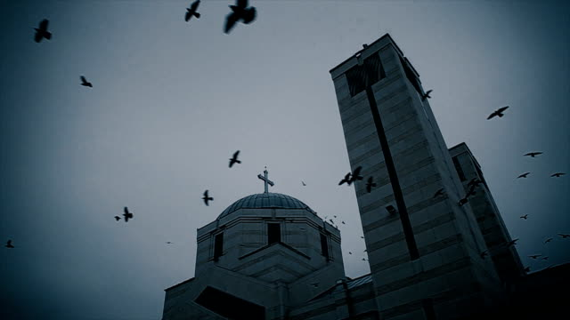 apocalypse scene.crow flies around the church - spooky stock videos & royalty-free footage