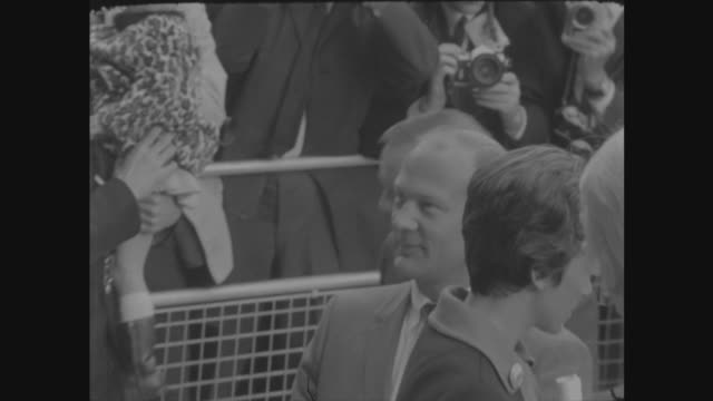 apollo 11 astronauts in london; england: london: us embassy: astronauts from car at us embassy michael collins and wife up steps: zoom in as neil... - wife stock videos & royalty-free footage