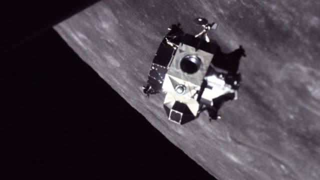 apollo 11 lunar module rotates and prepares for docking above moon surface - tied up stock videos & royalty-free footage