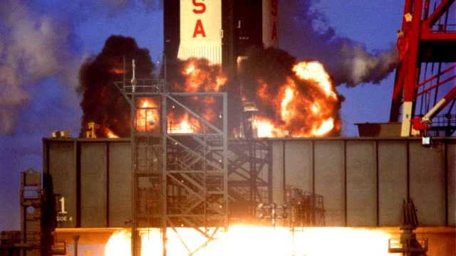 CU Apollo 11 rocket blasting off from launch pad rocket boosters firing