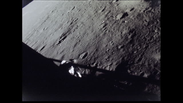 / apollo 12 astronaut working outside landing craft. apollo 12 astronaut on moon surface on november 19, 1969 in in space - 1969 stock videos & royalty-free footage