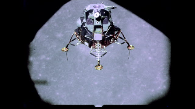 / apollo 12 lunar module orbiting above the surface of the moon apollo 12 lunar module above the moon on november 19 1969 in in space - 1969 stock videos & royalty-free footage
