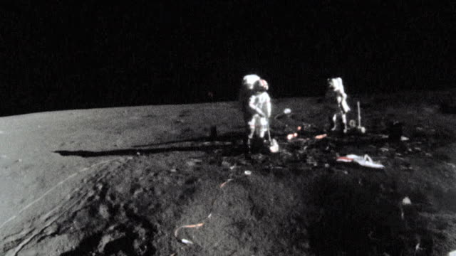 apollo 15 astronauts setting up black and decker cordless tool the apollo lunar surface drill used to remove core samples from the moon's surface - apollo 15 stock-videos und b-roll-filmmaterial