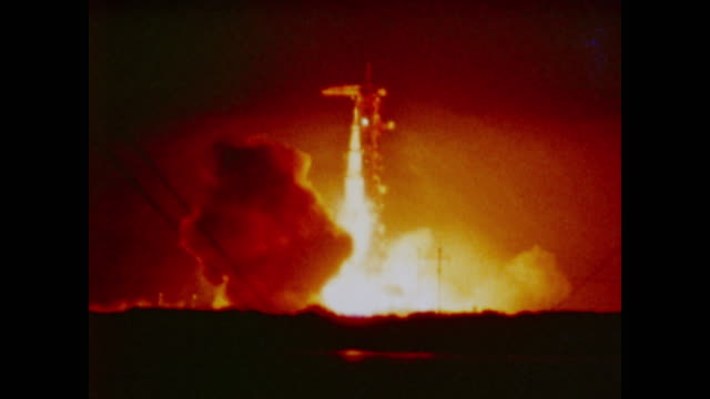apollo 17 roars to life in flames and fire on the launchpad at night - 1972 stock videos & royalty-free footage