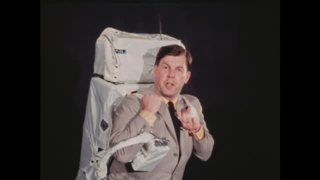 """apollo back pack; usa: texas: houston: int peter fairley with apollo astronaut back pack that will be worn to the moon sof - """"you may not see very... - control stock videos & royalty-free footage"""