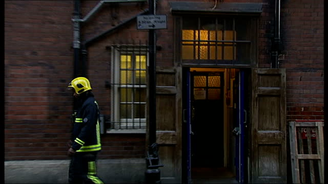 investigation work begins england london shaftesbury avenue ext police officers stand chatting with firefighter outside cordonedoff apollo theatre... - 非常線点の映像素材/bロール