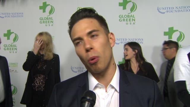 vídeos de stock, filmes e b-roll de interview apolo ohno on the event at global green usa 13th annual preoscar® party in los angeles ca - global green usa