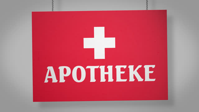 apotheke (pharmacy) german cardboard sign hanging from ropes. alpha channel will be included when downloading the 4k apple prores 4444 file only - german language stock videos & royalty-free footage