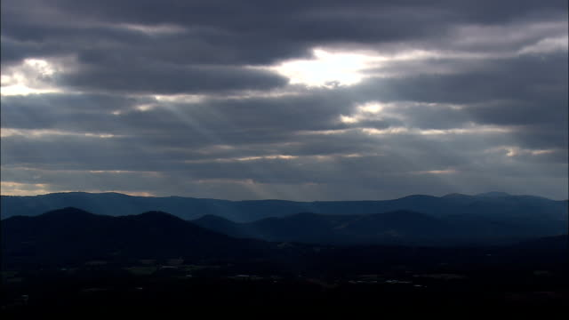 appalachian mountains and sun streaks - aerial view - north carolina,  surry county,  united states - arkansas stock videos & royalty-free footage