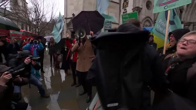 appeal court blocks third heathrow runway because of government climate change pledges; england: london: the strand: ext various of environmental... - papier stock videos & royalty-free footage