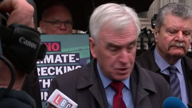 appeal court blocks third heathrow runway because of government climate change pledges; england: london: royal courts of justice: ext various of john... - lying down stock videos & royalty-free footage