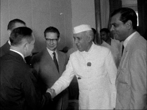 appeal for ceasefire / nehru meets laos commission in delhi; india: new delhi: int jawaharlal nehru with delegates / nehru photocall with others /... - ceasefire stock videos & royalty-free footage