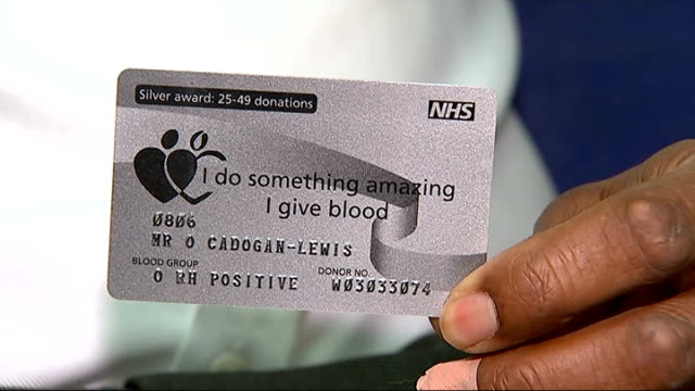 appeal for more people from black community to give blood england london orin lewis with tubes in arm giving blood in medical room close shot nhs... - pamphlet stock videos & royalty-free footage