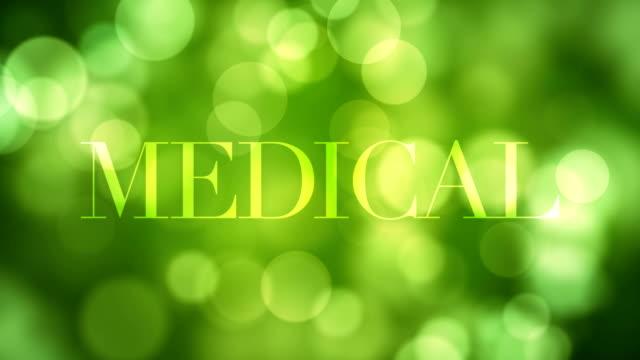"""""""medizinische"""" text erscheinen und nach einer weile mit moving-lights grün glitter auflösen, grünen defokussierten lichtreflexionen auf endlos wiederholbar bokeh hintergrund. gesundes leben, medizinische, wald konzeptvideo - aufblenden stock-videos und b-roll-filmmaterial"""