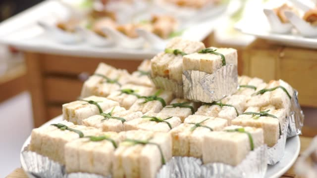 appetizer canape of mini sandwich on white plate for self-service at outdoor wedding events. - sandwich stock videos & royalty-free footage