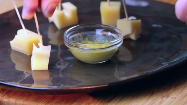 appetizers in mustard. - annick vanderschelden stock videos & royalty-free footage