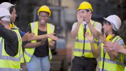 applådera med team factory engineer operating - applådera bildbanksvideor och videomaterial från bakom kulisserna