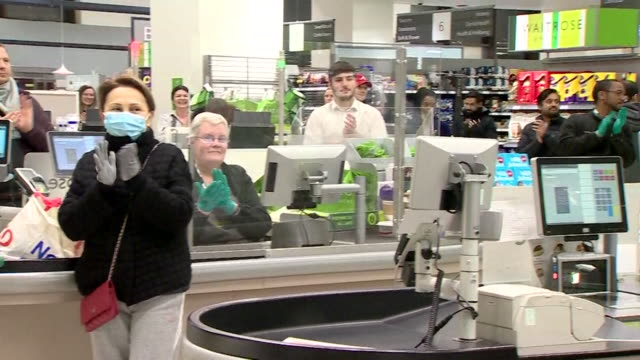 applause in waitrose supermarket for nhs and all key workers during the clap for carers event during the coronavirus crisis - thank you englischer satz stock-videos und b-roll-filmmaterial
