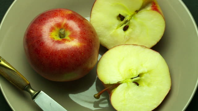 Apple and slices with knife