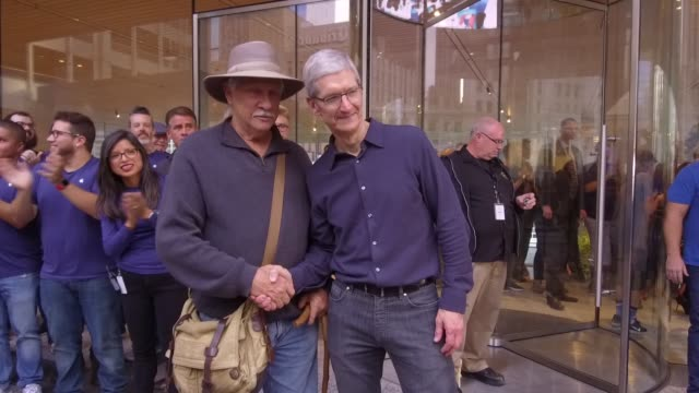 Apple CEO Tim Cook greeting some of the first customers as they enter the new Apple Store during the Grand Opening event in Chicago IL on October 20...