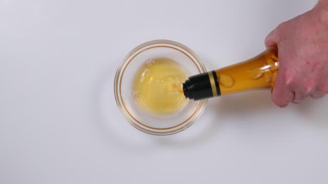 apple cider vinegar. - vinegar stock videos & royalty-free footage
