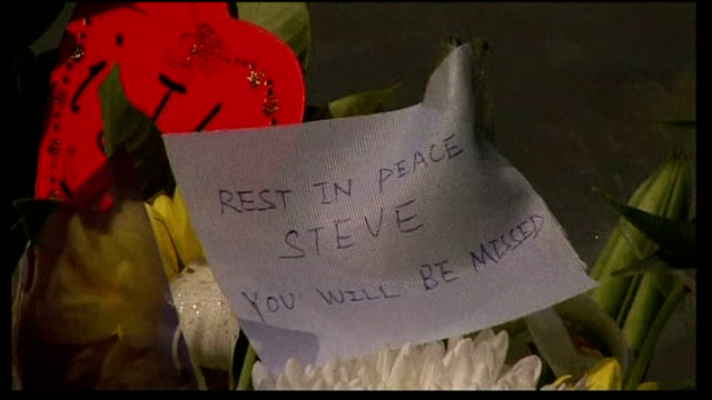 apple cofounder steve jobs dies aged 56 new york person leaving bouquet of flowers outside apple offices 'rest in peace steve' message on flowers... - founder stock videos and b-roll footage