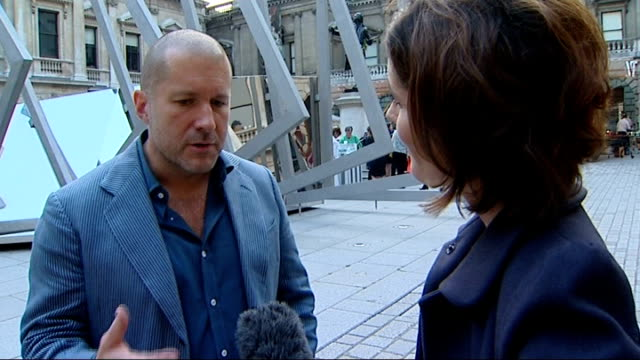 apple designer jonathan ive receives knighthood; england: london: royal academy of arts: ext ive interview with reporter in shot sot rob brydon and... - richard e. grant stock videos & royalty-free footage