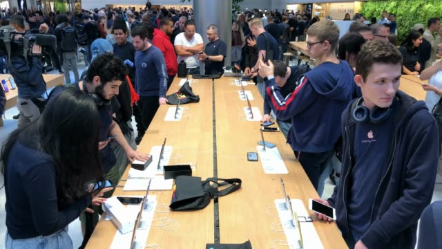 apple employees help customers as they shop at apple's flagship 5th avenue store on september 20 2019 in new york city apple's new iphone 11 goes on... - apple store stock videos & royalty-free footage