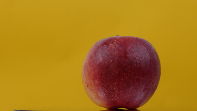 apple fruit turning on color background - computer monitor white background stock videos & royalty-free footage