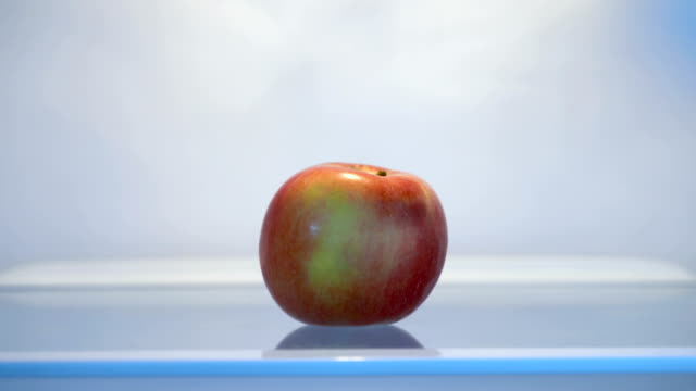 apple in empty fridge - refrigerator stock videos & royalty-free footage