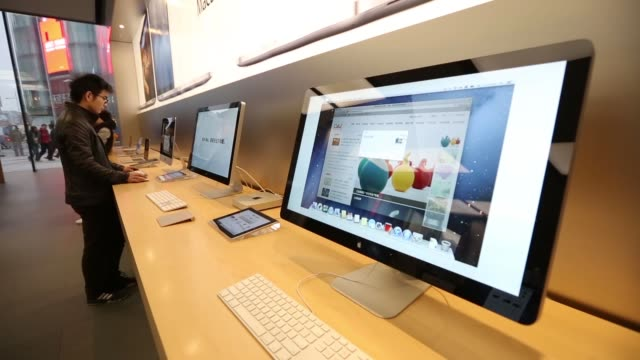 Apple Inc Mac Pro desktop computers sit on display at the company store in the Wangfujing area of Beijing High angle pan view customers try Apple Inc...