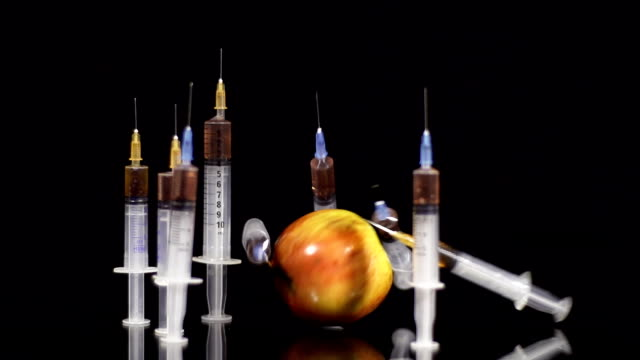 hd slow motion: apple knocking down syringes - genetic modification stock videos & royalty-free footage