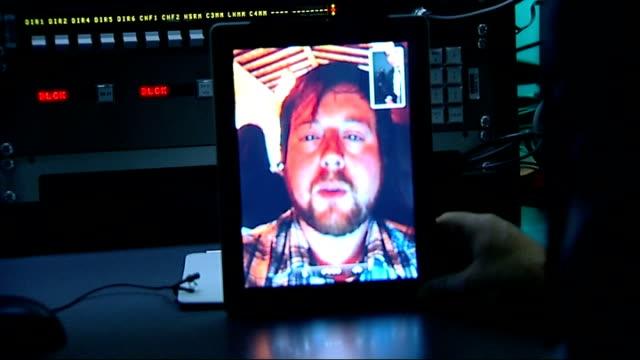 London Reporter interviewing man via iPad Mini Luke Peters interview on iPad Mini SOT