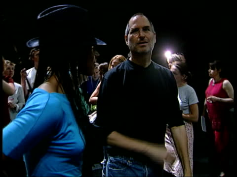 ITN ENGLAND London Singer Alicia Keys and Steve Jobs posing for photo opportunity at launch of Apple's iTunes online