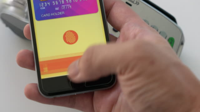 apple pay contactless payment 4k - tap to pay stock videos & royalty-free footage