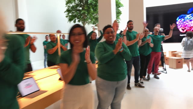 apple retail employees applaud and cheer as journalists arrive for a preview of the new apple carnegie library two days before the grand opening may... - apple store stock videos & royalty-free footage