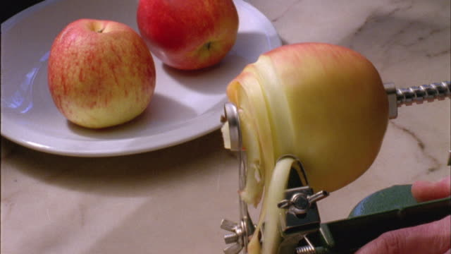 cu, apple rotating on peeler - peel plant part stock videos and b-roll footage